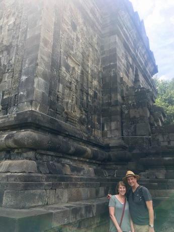 Parents by a temple