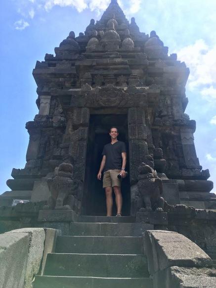 Standing in the door of a temple